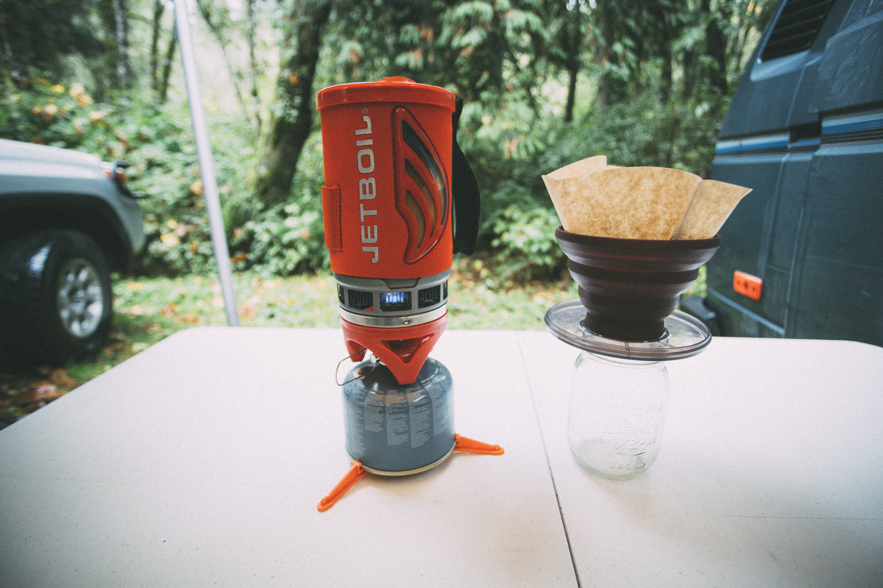 jetboil flash cooking system sitting on table beside pour-over GSI coffee south america gearlist