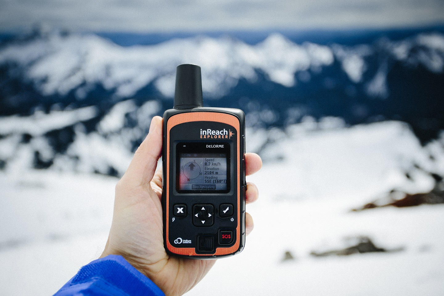 person holding Delorme Explorer InReach Garmin two-way satellite communication device with GPS coordinates south america gear list