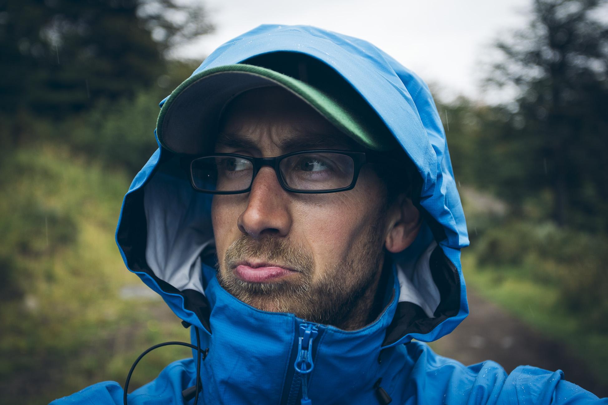 man wearing Westcomb windbreaker shell Apoc jacket in rain