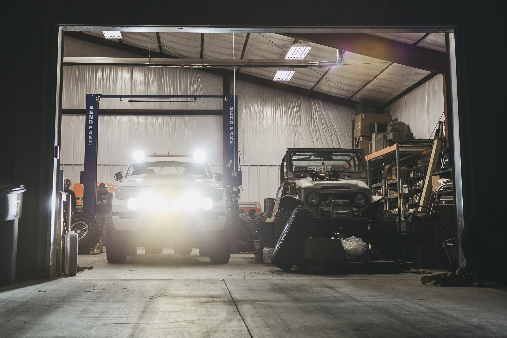 Toyota Landcruiser parked in garage with ARB Intensity Lights on